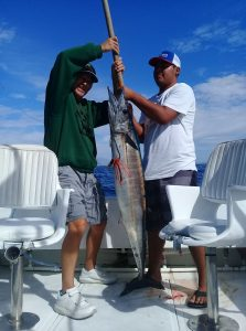 Kola and Crew catching a good size wahoo