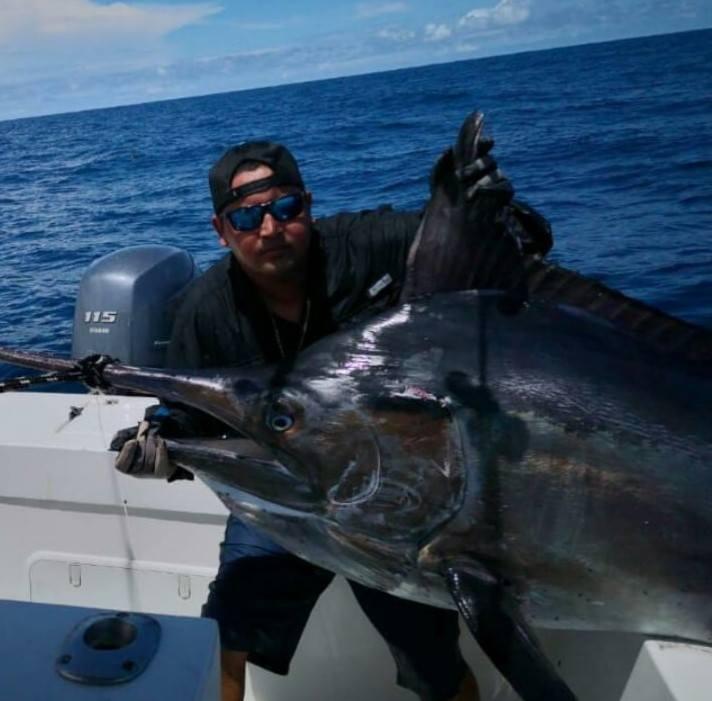 large black fish caught in ocean